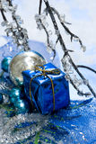 Blue gift box on snow Stock Images