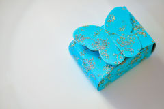 Blue gift box with sparkling butterfly Stock Image