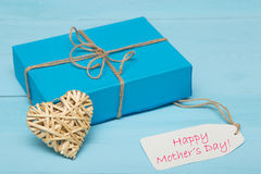 Blue gift box with straw heart and mothers day card Royalty Free Stock Photography