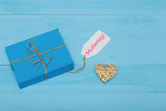Blue gift box with straw heart and mothers day card Stock Photos