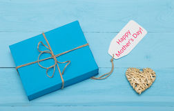 Blue gift box with straw heart and mothers day card Royalty Free Stock Image