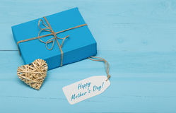 Blue gift box with straw heart and mothers day card Stock Image