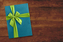 Blue gift box top view over wood Royalty Free Stock Photo