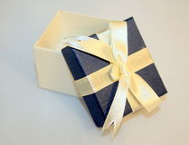 Blue gift box. On white background royalty free stock photography