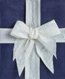 Blue gift box with white ribbon Royalty Free Stock Photos