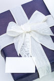 Blue gift box with white ribbon Stock Photography