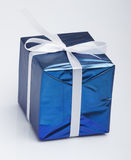 Blue gift box. With white ribbon Royalty Free Stock Photo