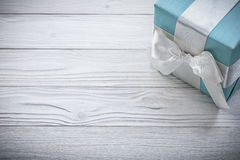 Blue gift box with white ribbon on wooden board celebrations con Royalty Free Stock Photography