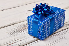 Blue gift box on wood. Royalty Free Stock Photos