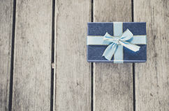 Blue gift box on wooden table, Royalty Free Stock Photos
