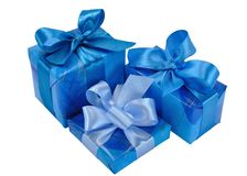 Blue Gift Boxes with Bows. Three Blue Gift Boxes with Bows Isolated on White Stock Photo