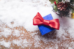 Blue gift boxes and chrismas christmas decoration things on snow Stock Photo