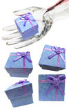 Blue Gift Boxes display collection. Blue gift boxes with lavender ribbon bows in a collection set in different poses, and with glass display hand isolated on Stock Images