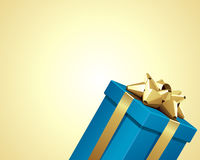 Blue gift with gold bow Royalty Free Stock Photo