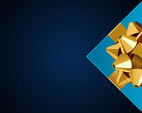 Blue gift with gold bow top view Stock Photography