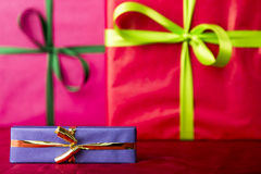Blue gift with golden bowknot Royalty Free Stock Photos