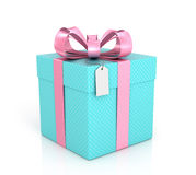 Blue gift with red ribbon, bow and tag. On a white background Stock Photography