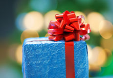 Blue gift with a red ribbon Stock Photography