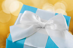 Blue giftbox with white  bow Stock Photos