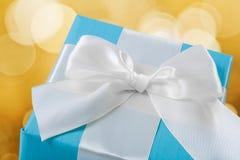 Blue giftbox with white  bow Stock Photos