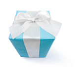 Blue giftbox with white ribbon and bow isolated on white Royalty Free Stock Photo