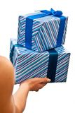 Blue gifts boxes in hands Royalty Free Stock Image
