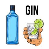 Blue gin bottle, hand holding glass with ice and lime Stock Image