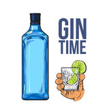 Blue gin bottle, hand holding glass with ice and lime Stock Photo