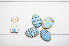 Blue gingerbread cookies on a wooden background Royalty Free Stock Image