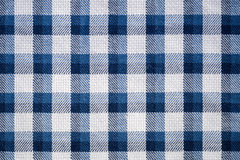 Blue gingham cloth closeup. Closeup of the blue gingham cloth texture background Stock Image