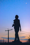 Blue girl with camera silhouette in the street night Royalty Free Stock Images