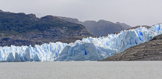Blue Glacial Ice meeting a Glacial Lake Royalty Free Stock Photography