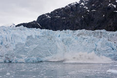 Blue glacier calving Stock Photography