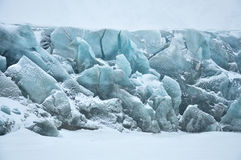 Blue glacier covered by snow. Cold snowy winter day, Greenland Stock Photos