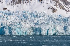 Blue glacier in Kongsfjorden fjord in Svalbard. A Norwegian archipelago between mainland Norway and the North Pole royalty free stock photos