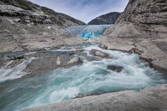 Blue glacier with river Nigardsbreen in Norway Royalty Free Stock Photography