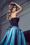 Blue glamour girl. Fashion girl with blue skirt and black corset Royalty Free Stock Images