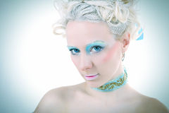 Blue  glance. A beautiful girl in style of marie antoinette and today techno Royalty Free Stock Photos