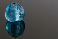 Blue glas gem stock image