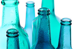 Blue Glass. Background with creative bottles. blue bottles Royalty Free Stock Photography