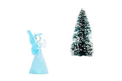 Blue glass angel praying near christmas tree. Blue glass angel praying near tree on white background royalty free stock photo
