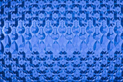 Blue glass background. Glass elements are laid out on a blue background Royalty Free Stock Photo