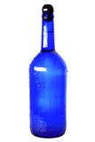 Blue glass bottle with cap Stock Image