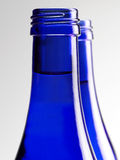Blue glass bottle of soda Royalty Free Stock Image