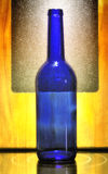 Blue glass bottle with wooden board Royalty Free Stock Photography