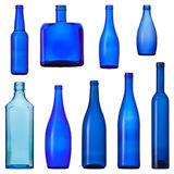 Blue glass bottles. Set of color blue glass bottles, isolated on white background Royalty Free Stock Photos