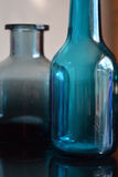 Blue Glass Bottles. Two small blue glass bottles stock photos