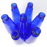 Blue glass bottles on a white background. Closeup Royalty Free Stock Photography