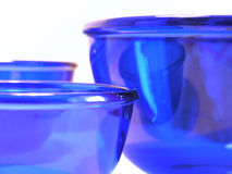 Blue glass bowls. Three blue glass bowls Stock Images