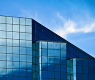 Blue Glass Building. Reflections of the sky  on a modern, blue glass building Royalty Free Stock Photo